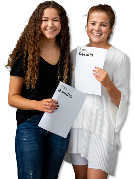 Two students showing exam results